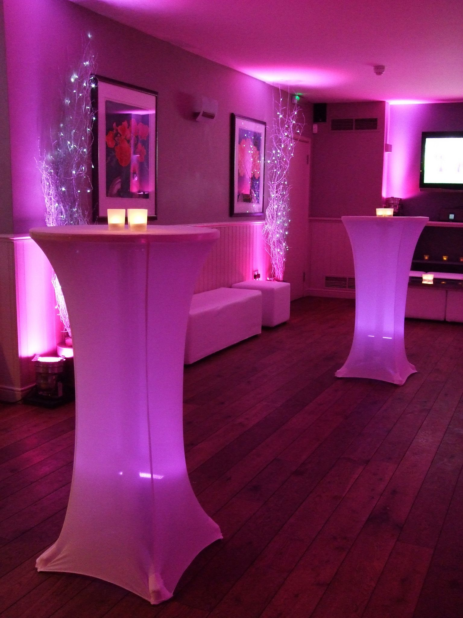Sands at Bleak House Surrey - Illuminated poseur tables, wall uplighters, white birch with cool white pealights, white chill-out furniture and frosted votive holders by www.stressfreehire.com #venuetransformers