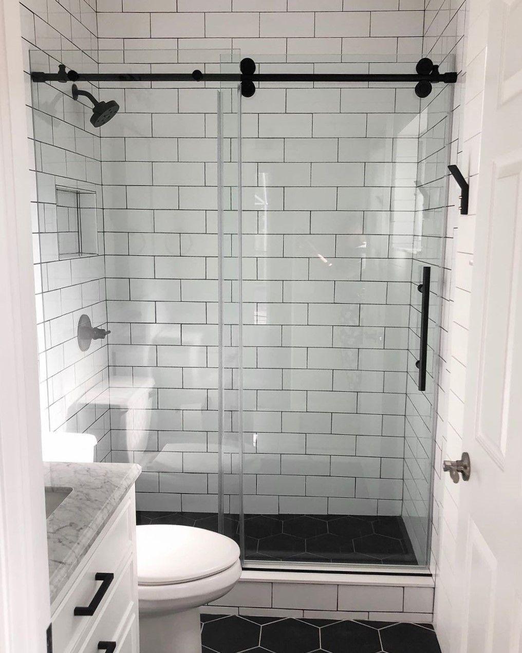 A Dreamline Frameless Glass Shower Door With Trending Black Accents In This Modern Bathroom Design In 2020 Shower Doors Sliding Shower Door Modern Bathroom Design