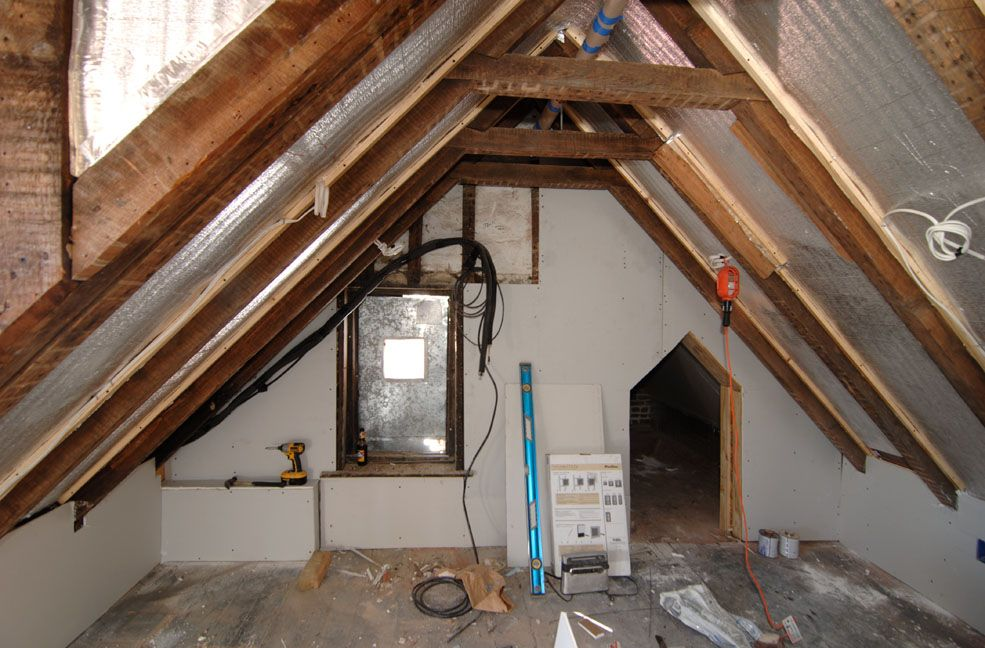 Attic space was a claustrophobic oven. Low ceilings, poor insulation and a huge old AC machine that we removed to find additional window and strorage space behind.  #charleston #historic #renovation #attic #timber #eastbay #home
