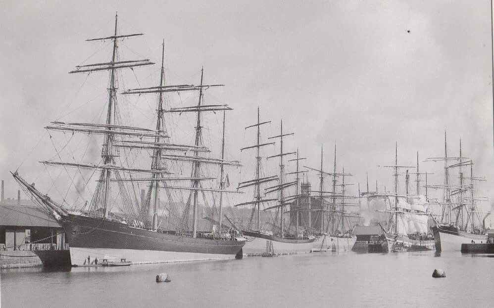 Dundee Harbour 1888 during Juteopolis. The ships are Euterpe, Ardencraig, Blythswood and Nile. Clocktower in the background is now housing.