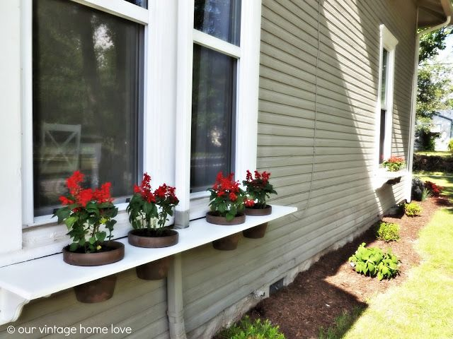 DIY Window Boxes, these are a different take on window boxes and are pretty cool.