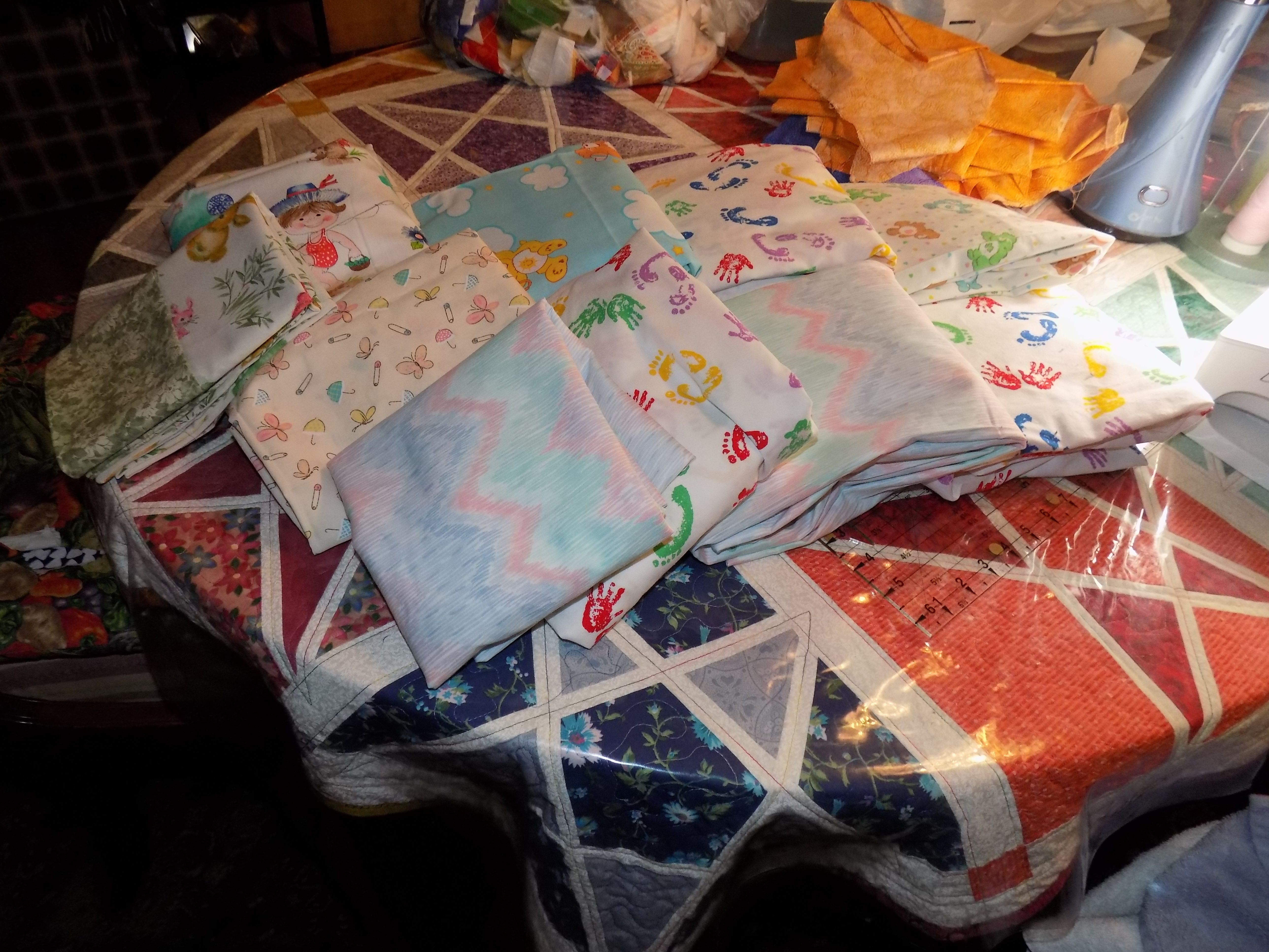 Pack 'n Play sheets and crib sheets that Anne V. made to donate to Little Singer…