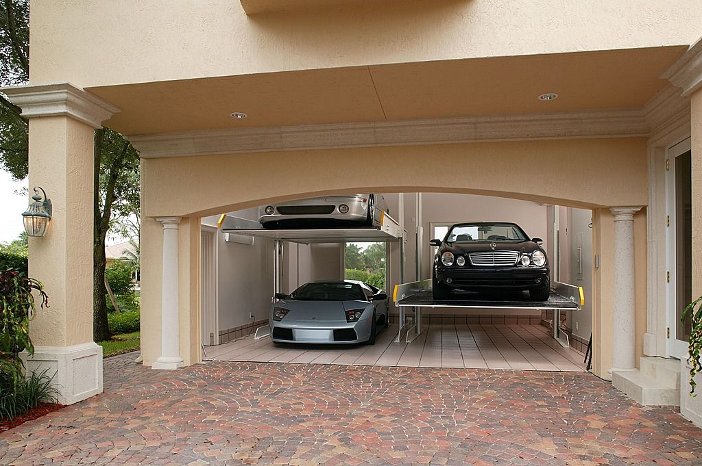 Hydraulic lifts maximize space and turn your two car for 4 stall garage