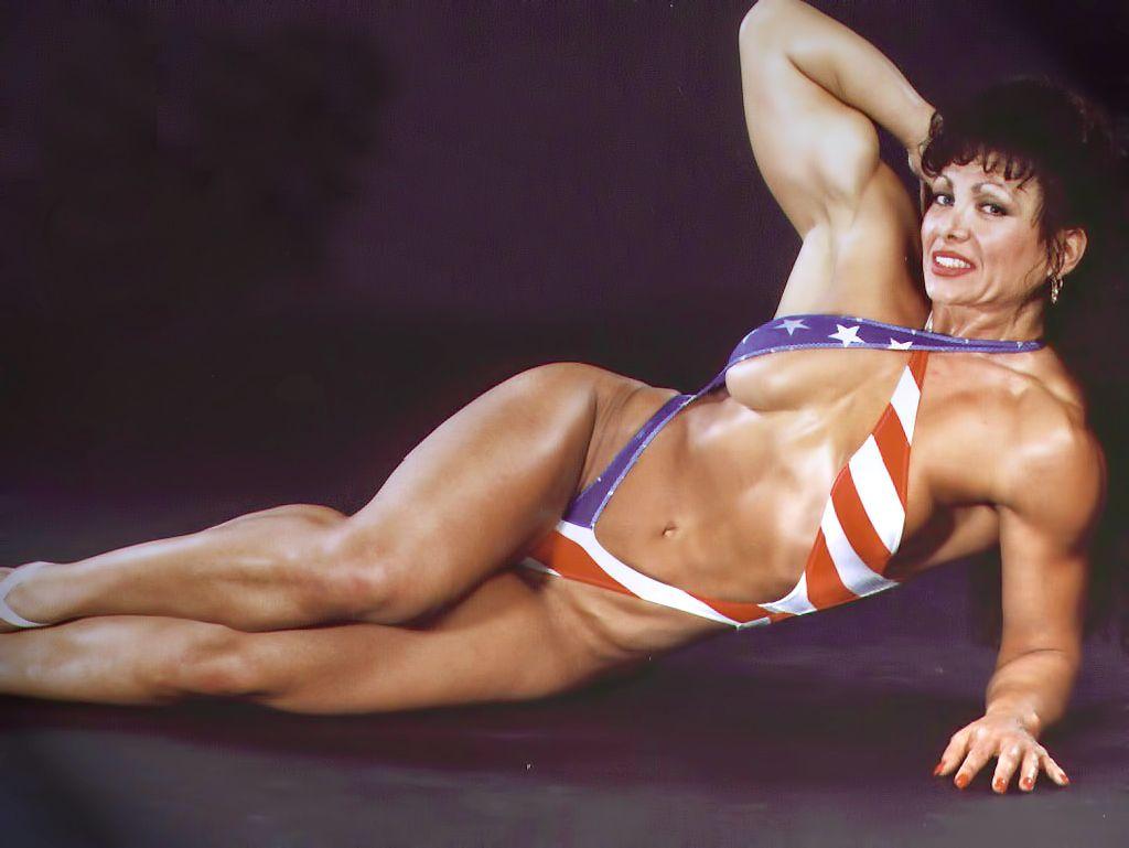 Female bodybuilder scissoring men