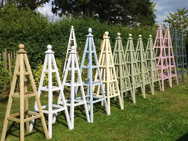 Selection of wooden garden obelisks at Duchy of Cornwall Nursery