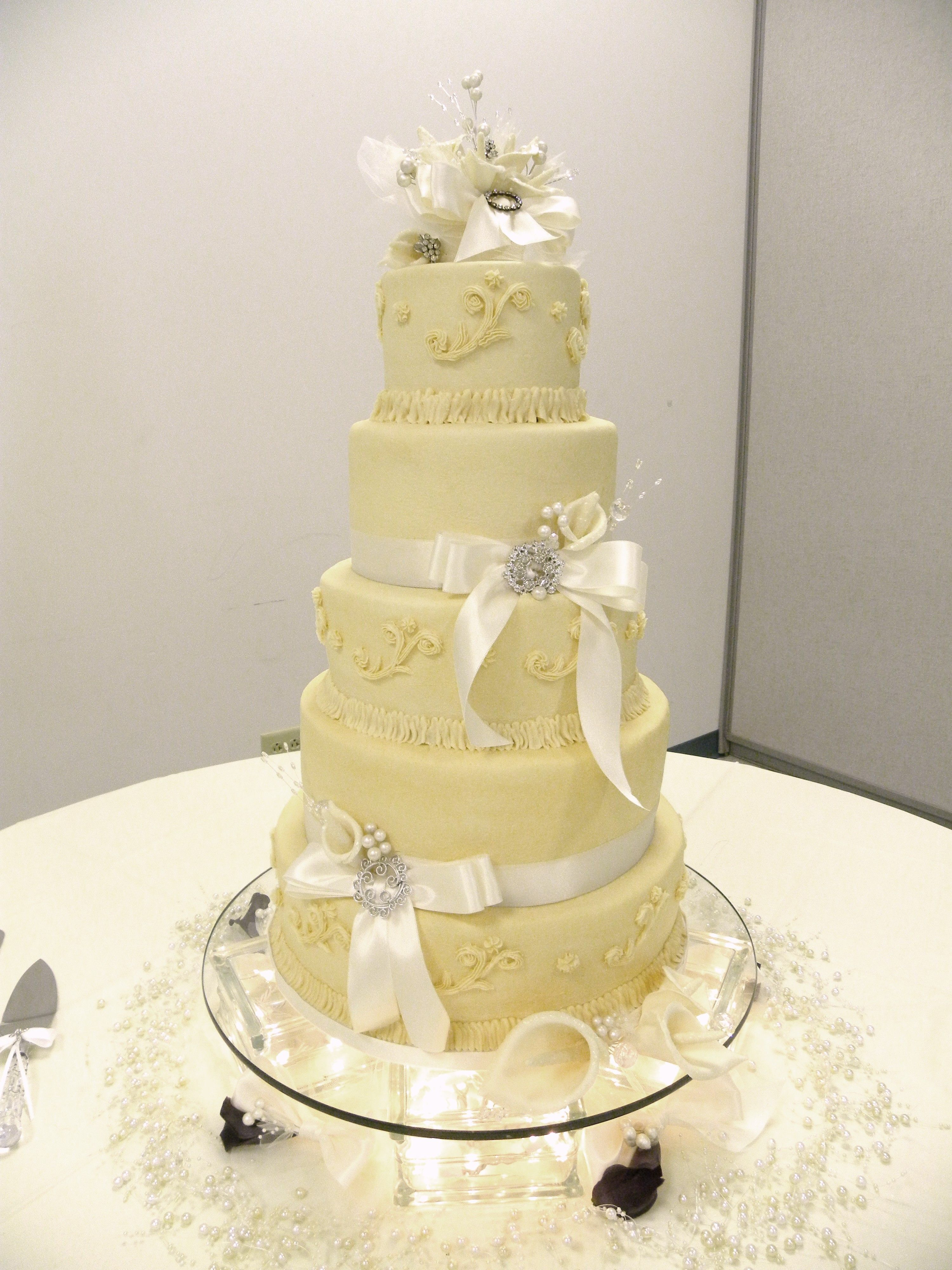 5 tier ivory butter cream frosting wedding cake, with gum paste ...