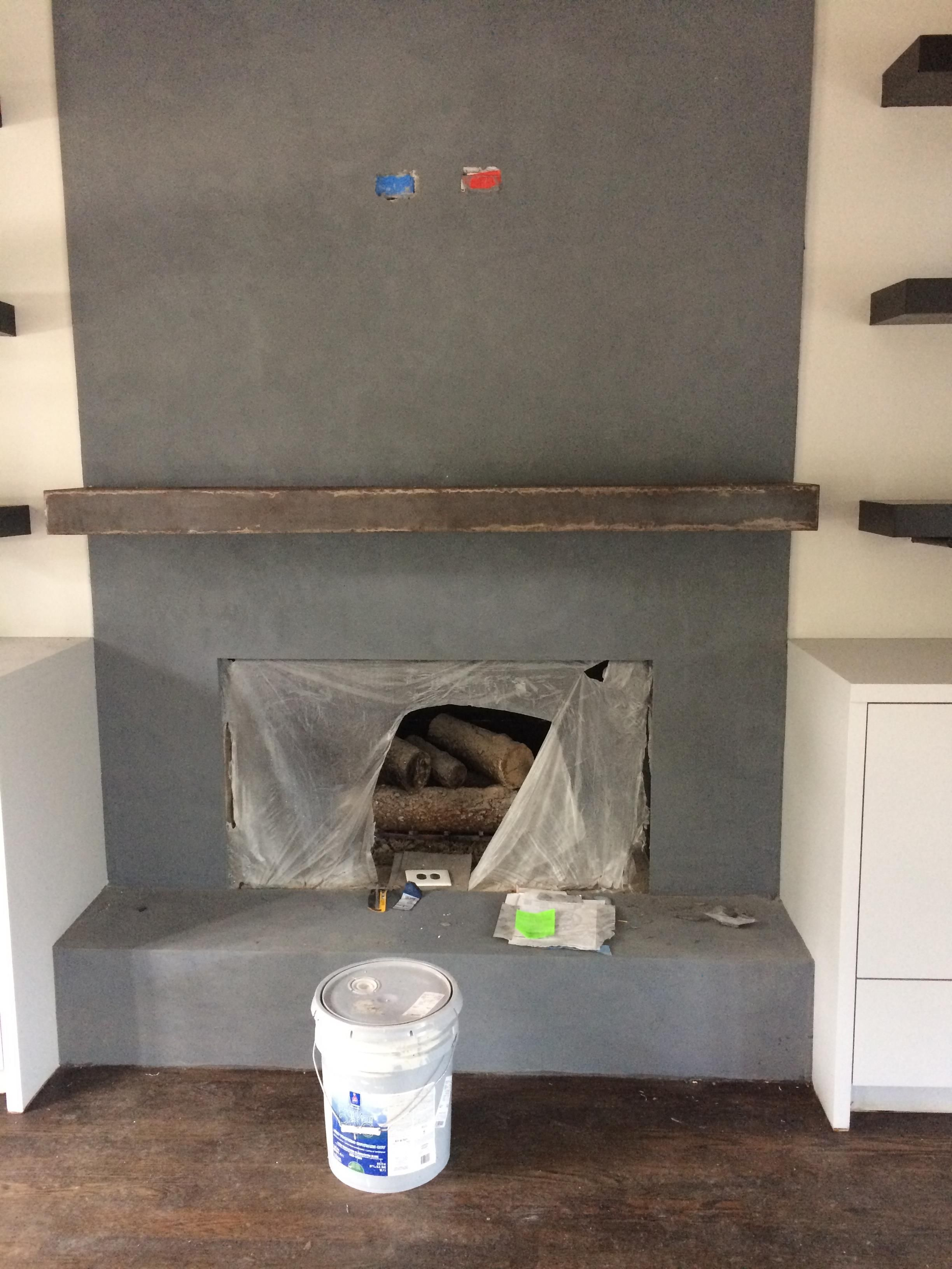 the dark grey stain on the concrete fireplace really pops against