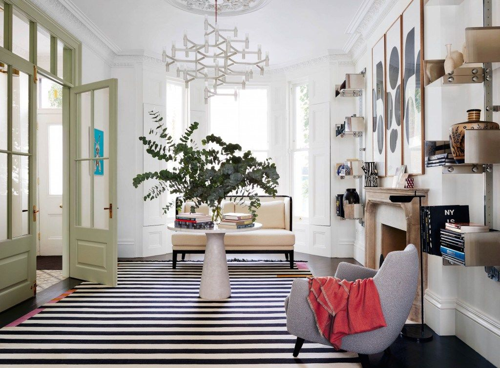 Feature, Notting Hill town house, contemporary, modern, graphic, geometric patterns, family home, bright, interior, sitting area, leading into entrance hall, marble table, fireplace, monochrome floor, plant