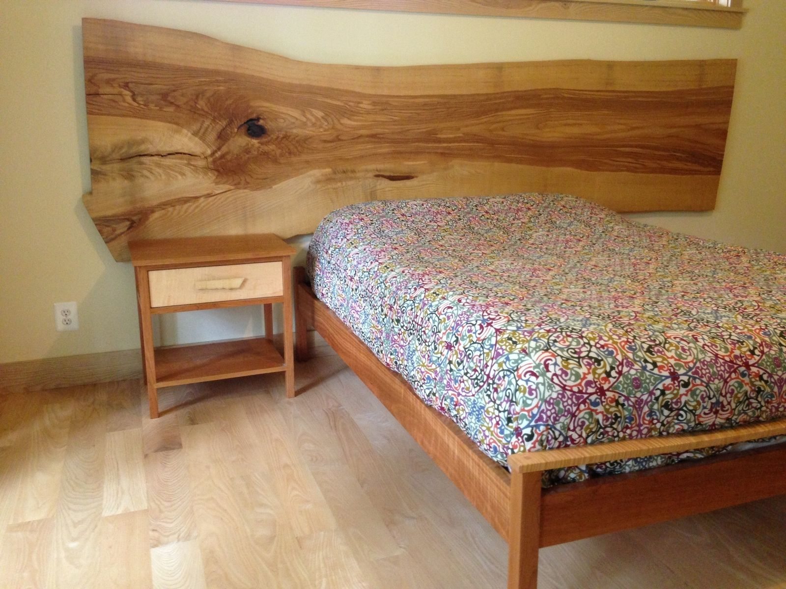 Oak slab as a headboard. Absolutely love this. Would be