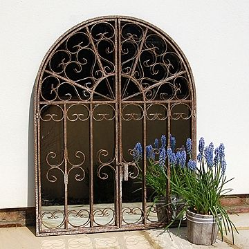 This charming arched window mirror will make a wonderful focal point to your garden. With its decorative scroll frame, you can choose to have the doors open or closed and they fasten with a simple latch. The rustic metal frame has been distressed to give it an aged appearance with lovely tones of cream, bronze and red coming through. #rustic #mirror £150