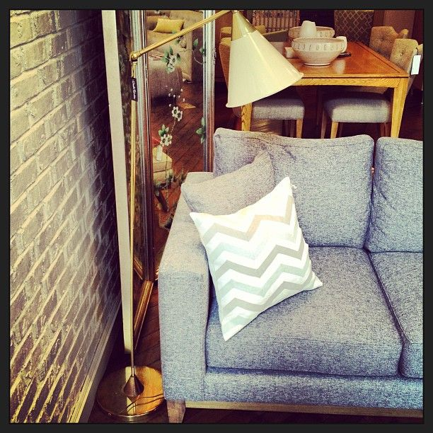 Spring Zig Zag Pillow and Write Sofa at 77Wooster - pairs perfectly with the one-of-a-kind vintage lamp.