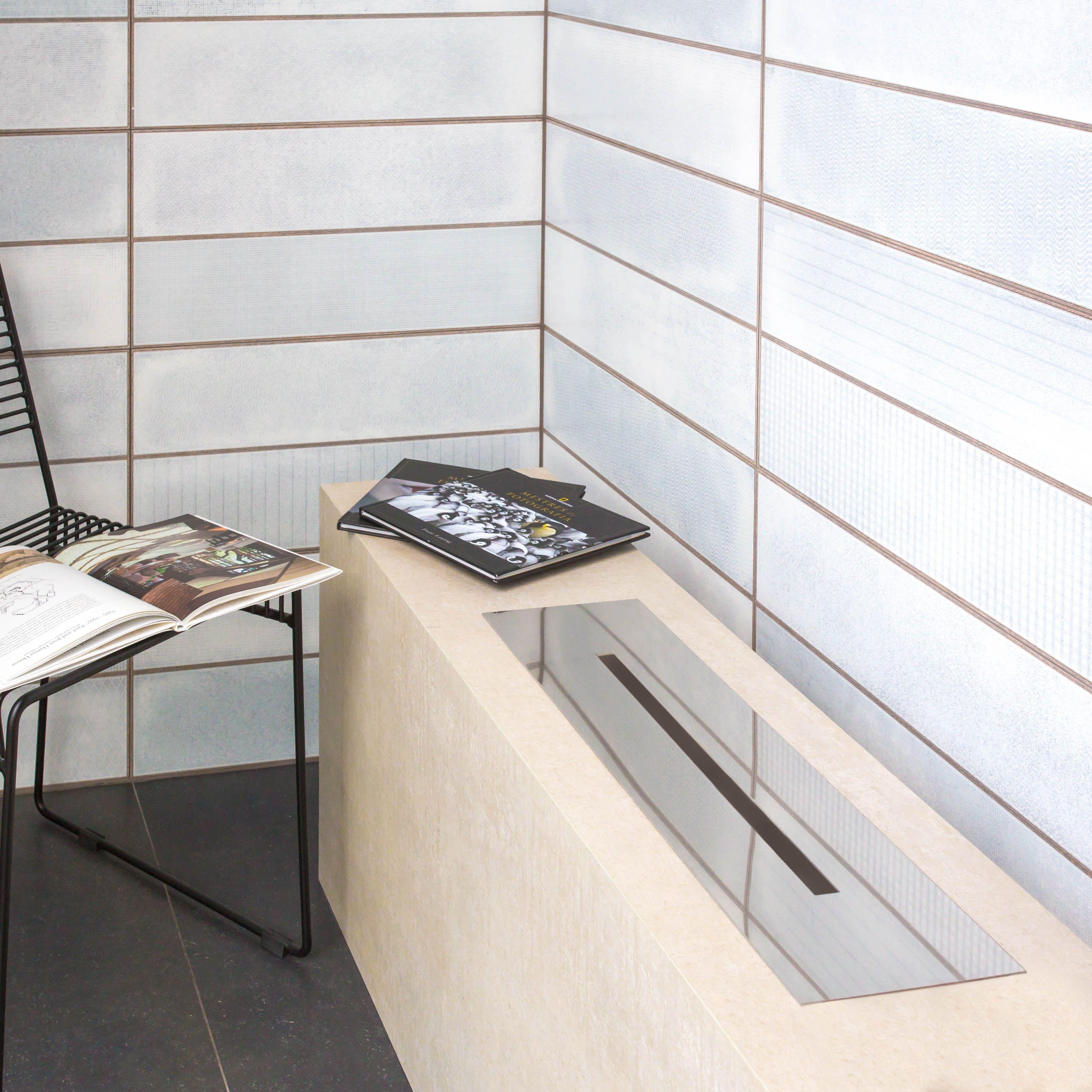 O porcelanato é o material ideal para lareiras por sua alta resistªncia ao calor e facilidade de limpeza Essa lareira foi executada pela ficina