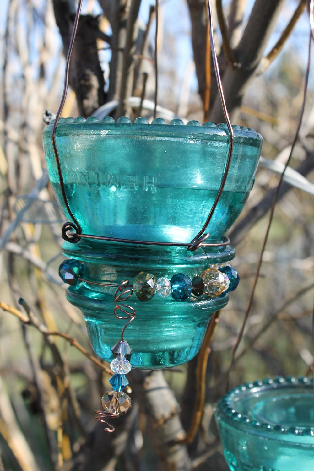 So normally, I just sell my finds, however my wife had something special in mind for these beautiful old Hemingray 45 glass insulators.  These insulators are some of the most common youll see. They were produced from 1938 until the early 1960s.  So to add to their beauty, my wife added copper wire and beading to create these beautiful hanging candle holders. These would be a great addition hanging with a burning tea light on a deck or from a tree.  From the top of the hook to the bottom of…