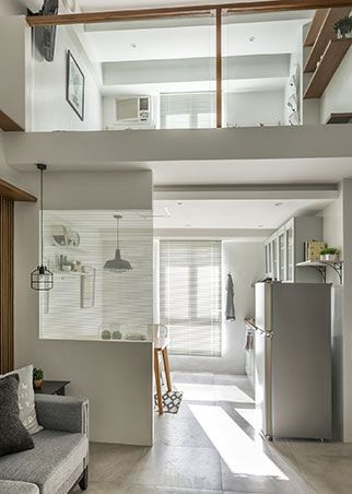 To make the 38sqm condo appear bigger than it actually is, the interior designer replaced the existing dry wall with clear glass panels. The new glass panels make the loft-type unit appear airy, bright, and spacious.