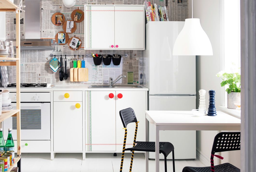 Kitchen with white IKEA shelving unit and dining