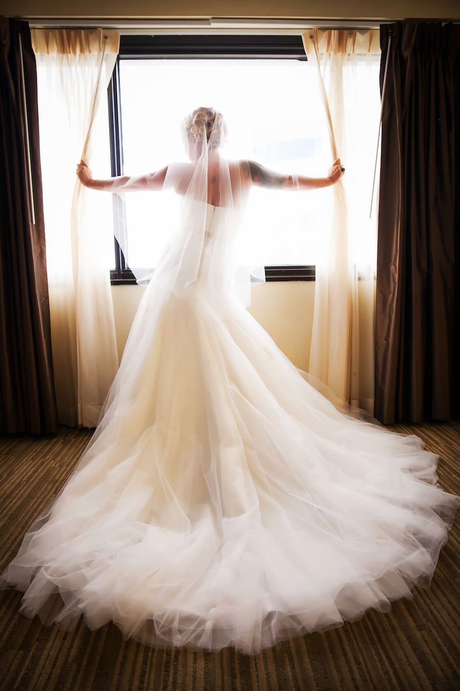 Indoor Bridal Wedding Portrait In Window With Strapless White Dress And Veil