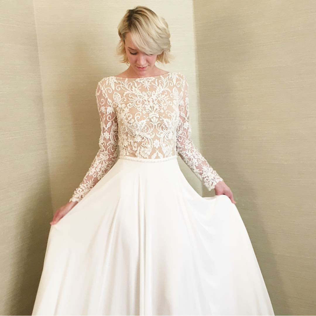 Modest wedding dress with long sleeves and a flowing skirt from alta