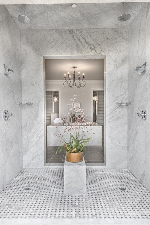 Shower. The Walk In Shower Features Marble Slab Walls And Marble  Basketweave Mosaic Tile Floors.