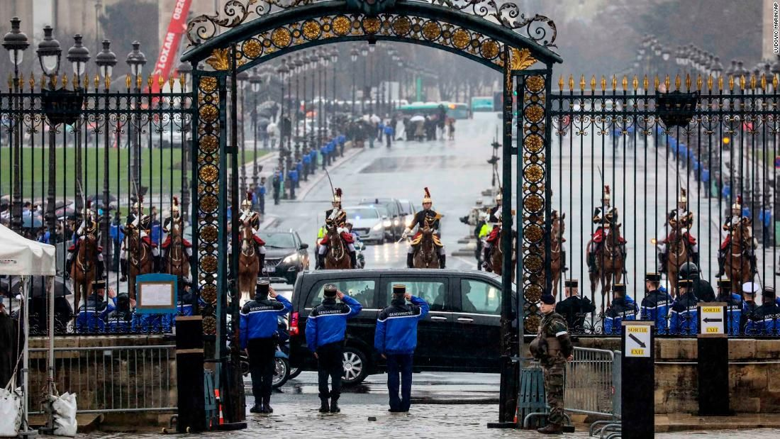 France honors hero officer who swapped places with hostage
