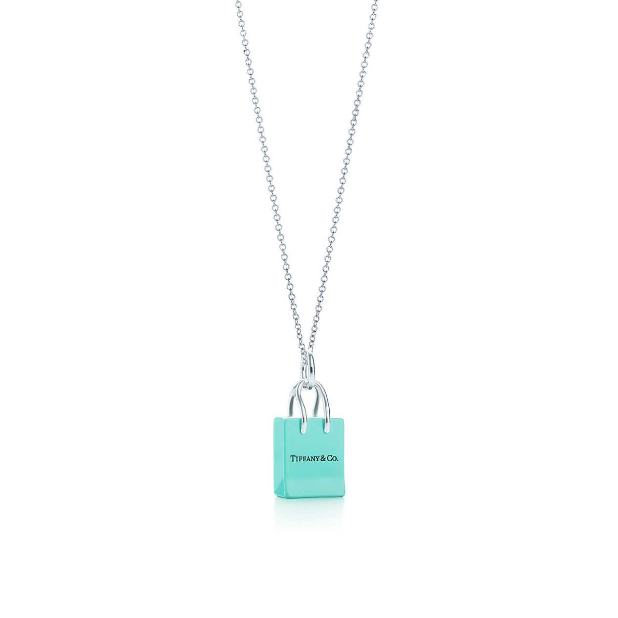 850143a681 Shopping Bag charm with enamel finish in silver on a chain. | Tiffany & Co.