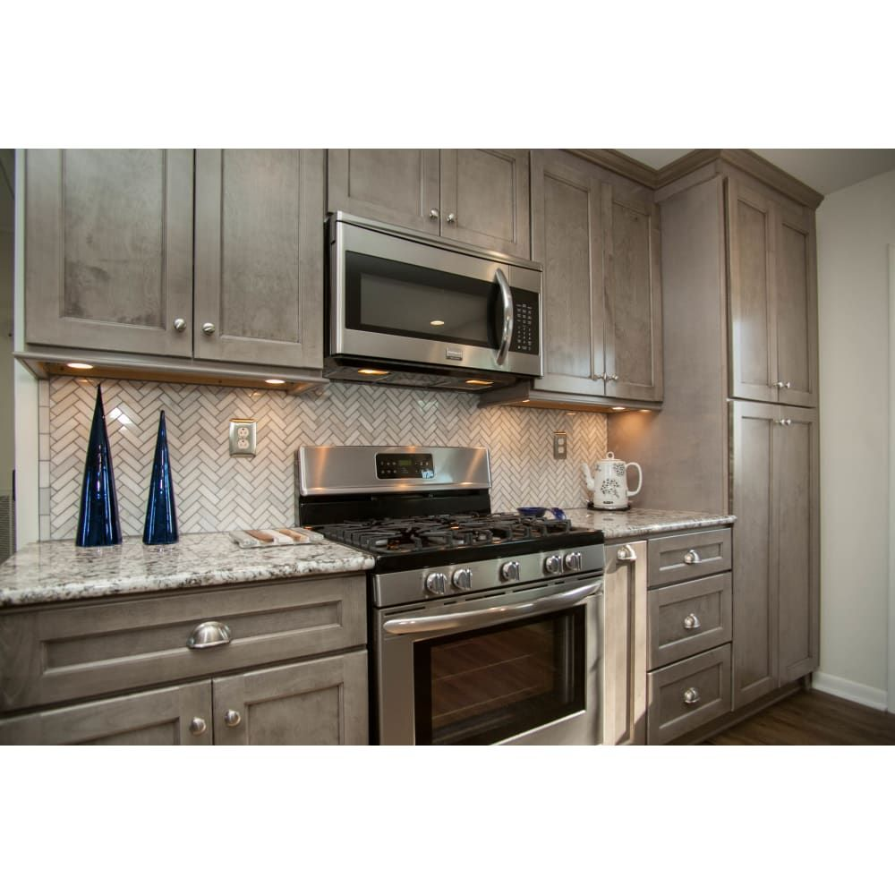 the norris gray kitchen line has a washed neutral gray stain which allows the grain of the wood on kitchen decor grey cabinets id=85794