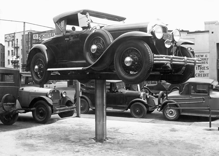 Auto Repair Shop Lift Photograph by Underwood Archives | Old ...