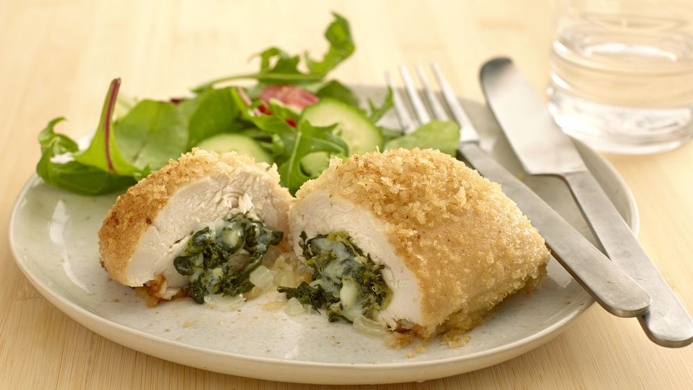 Elegant... and easy!  Dress up chicken breasts when you roll them up with a cheesy spinach mixture.