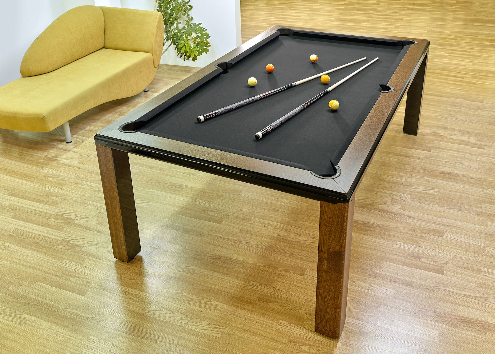 Convertible Table by Vision Billiards can be used as both a pool