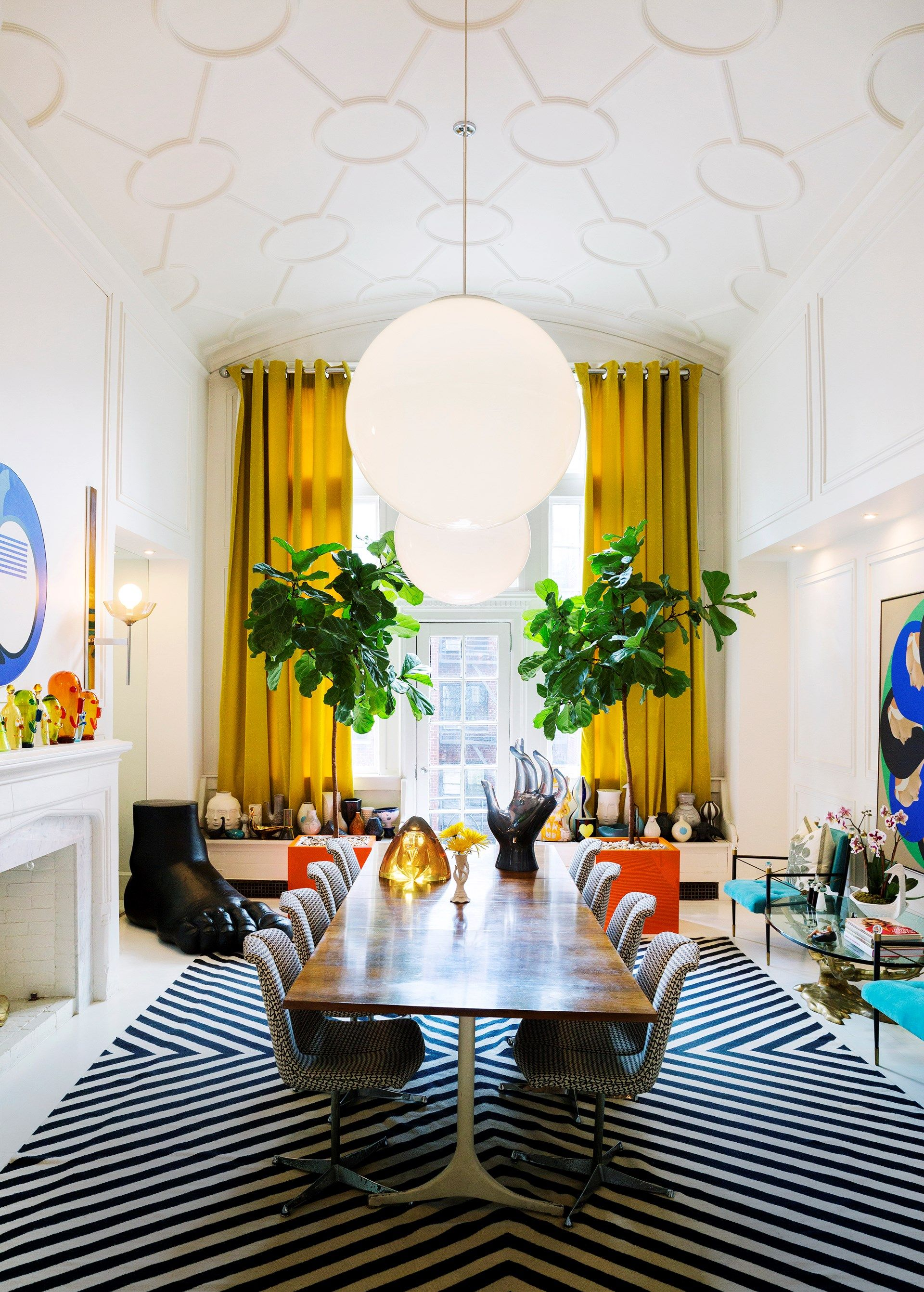"""Two Fiddle-leaf figs (*Ficus lyrata*) take pride of place in the dining room of American designer and entrepreneur, [Jonathan Adler](http://www.homestolove.com.au/jonathan-adlers-greenwich-village-apartment-3009
