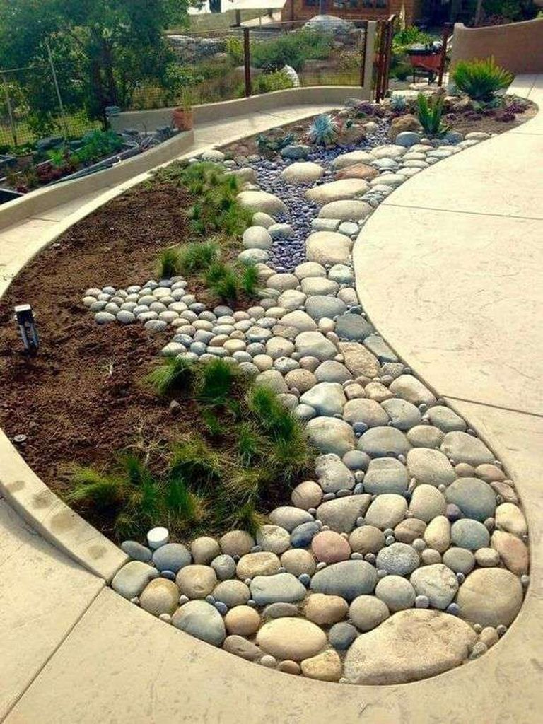 40 Incredible Edging Garden for Your Front Yard is part of Outdoor gardens, Rock garden landscaping, Yard landscaping, Small gardens, Rock garden, Gravel garden - Curved garden edging may sound complicated, but it's a surprisingly effortless effect that you could recreate yourself without much work! Developing a garden edging and a walkway, or developing a walkway as your garden edging is an excellent idea for smaller gardens  You may also add some coloured glass stones for additional vibrancy The concept is straightforward, but you can require some excess muscle help to carry the stones and put them in the most suitable spots  Lawn edging is a superb method to add curb appeal and value to your house  Nowadays you are in possession of a professional looking edge