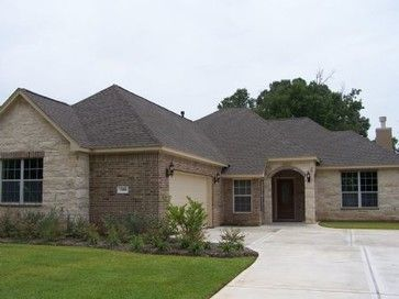 traditional brick and stone ranch style home in the greater houston area by kurk homes