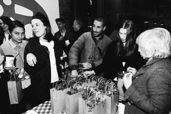 Annie Folk selling the tea towels... and guests receiving their goodie bags at our PIZZA launch party !