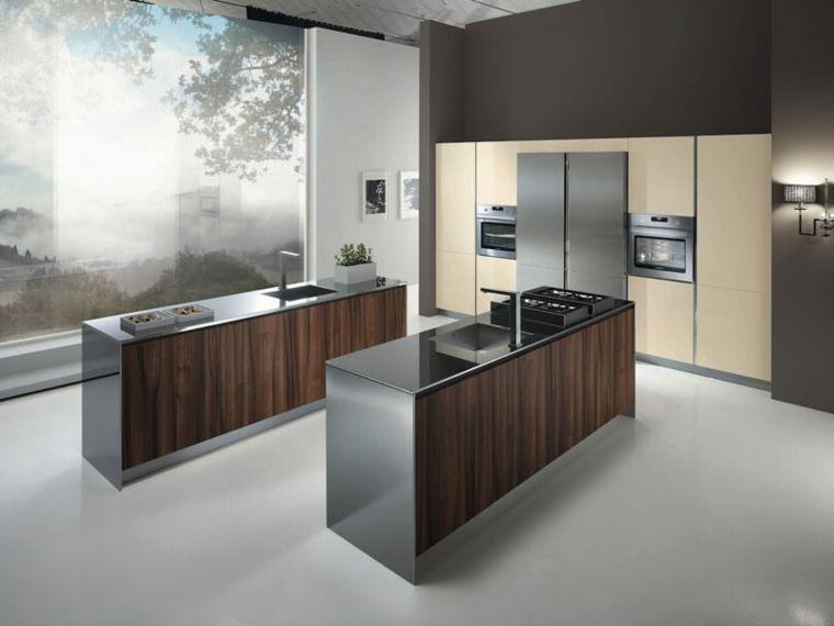 cucina moderna dallo stile essenziale con una doppia isola e ...