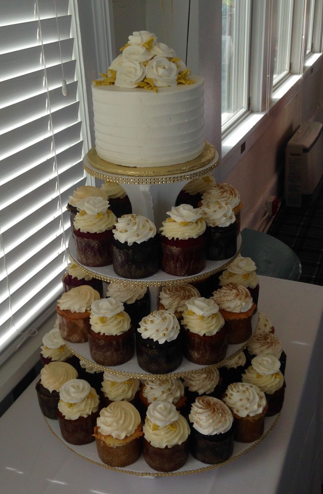 Cupcake tower with gold accents for a 50th Anniversary