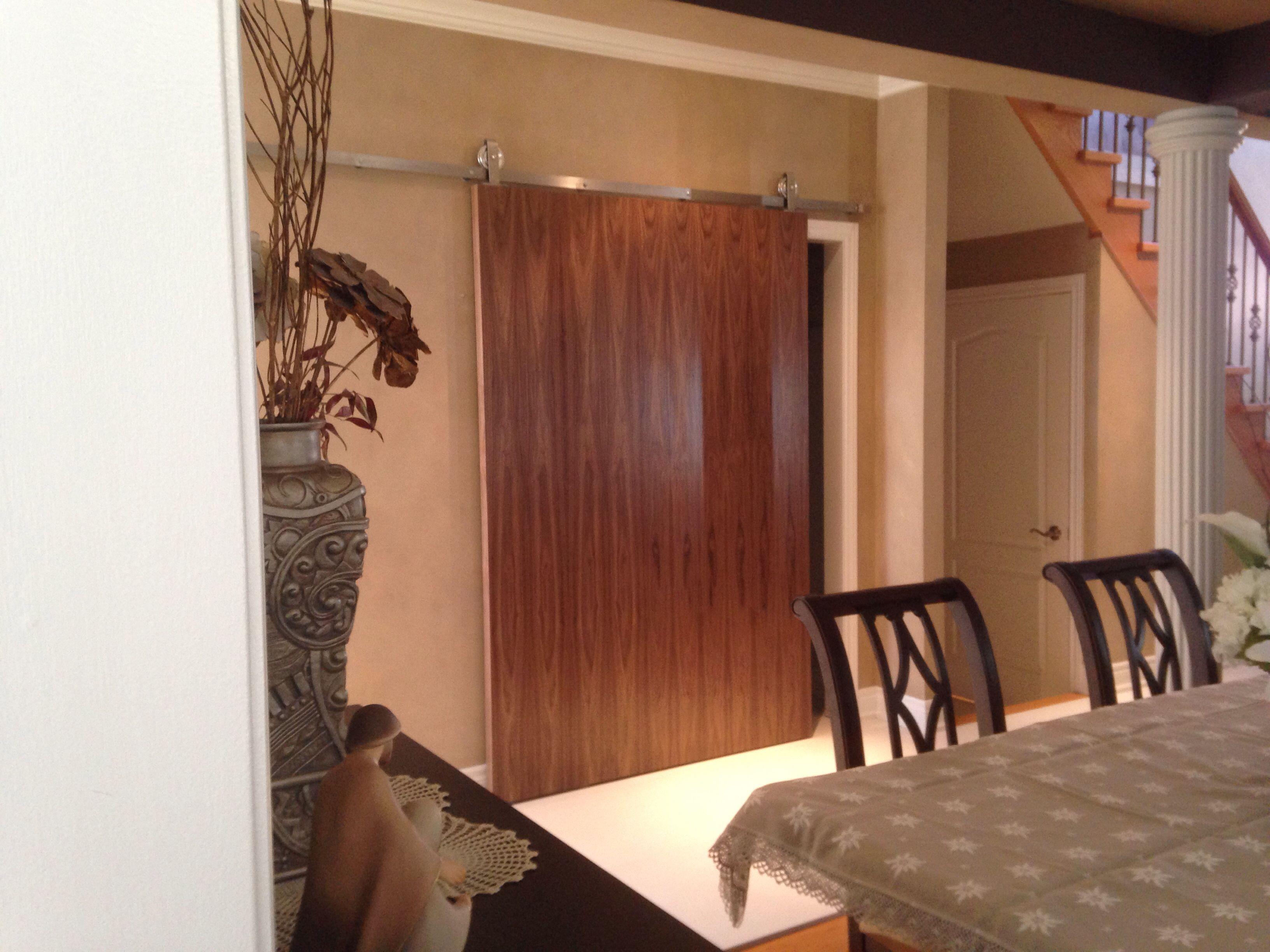 walnut veneer slab door on top mount stainless steel barn door hardware