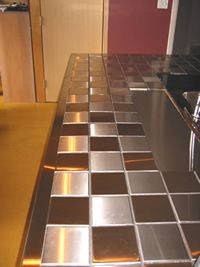 steel wall tile kitchen countertop 10x10cm tile unique interesting durable - Tile Kitchen Countertops Ideas