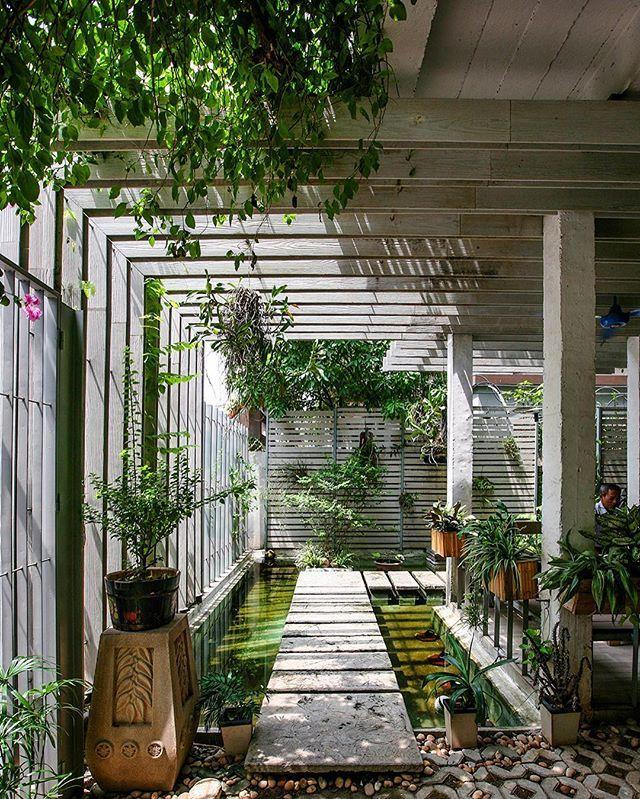 In Hanoi Vietnam The Mein Garten Showroom By Studio 102 Provides A Light Filled Office Space Infilled Garden Landscape Design Landscape Design Garden Design