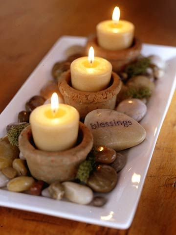 No fuss Thankdsgiving centerpiece using rocks, small candles in tiny flowerspots.  No flowers to keep fresh and easy to see other diners across the table nothing to look around or thru.