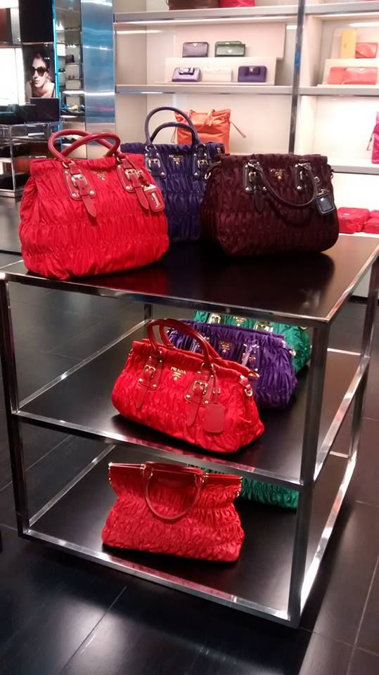 c9d3f6badea6 Colorful bags at the Prada factory outlet in Italy. Shopping In Italy, Shop  Around