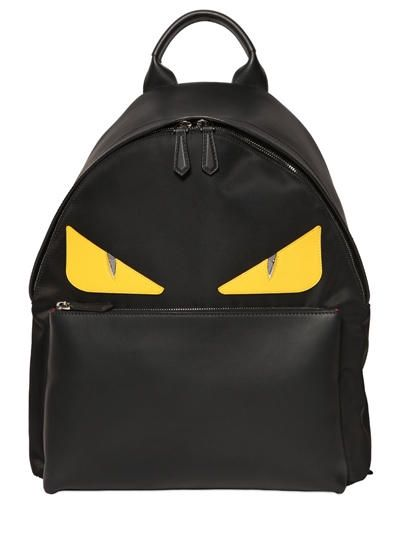 99377ae361e7 FENDI Monster Leather Patched Nylon Backpack