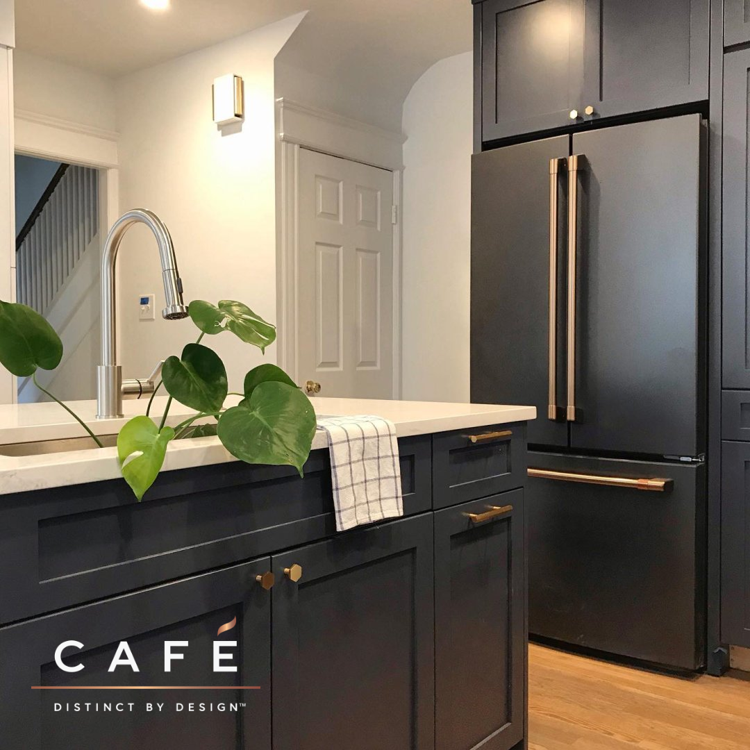 The Moody Dark Cabinetry And Matte Black Cafe Appliances Are Just Beautiful Together In This Kitc Black Appliances Kitchen Kitchen Remodel Kitchen Inspirations