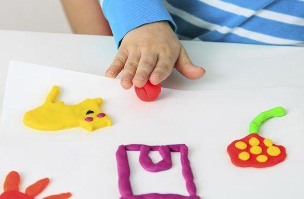 Kindergartners enjoy making colorful shapes.