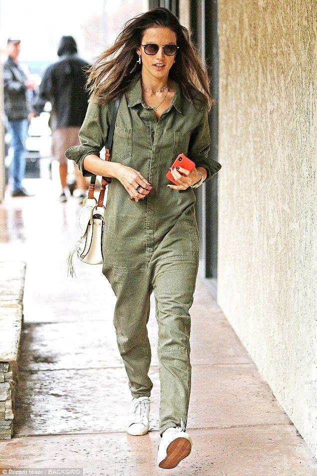 Alessandra Ambrosio slips into Top Gun-style jumpsuit on rainy day
