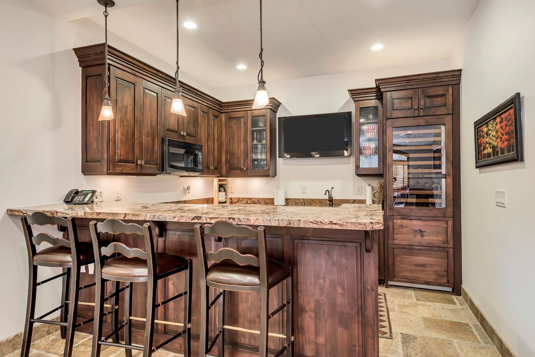 The lower level walkout boasts a second full kitchen, 2 junior suites, a family room, and a den. #Kitchen #KitchenDesign #KitchenDecor #WindermereUtah #UtahHomes #HomesForSale #WoodenCabinets #WoodenCabinetry #DreamHome #ParkCityHomes #KitchenCabinets #DreamKitchen