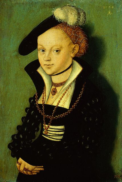 Cranach, Lucas the Younger- Christiane von Eulenau, 1534, wearing a goldhaube, a richly decorated gold snood or hairnet, which could also be topped off with a hat, often tilted to one side. There are a lot of these early goldhaubes to be found in portraits by Lucas Cranach the Younger.