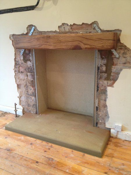 Installing beam above a fireplace living room for Wood fireplace surround designs