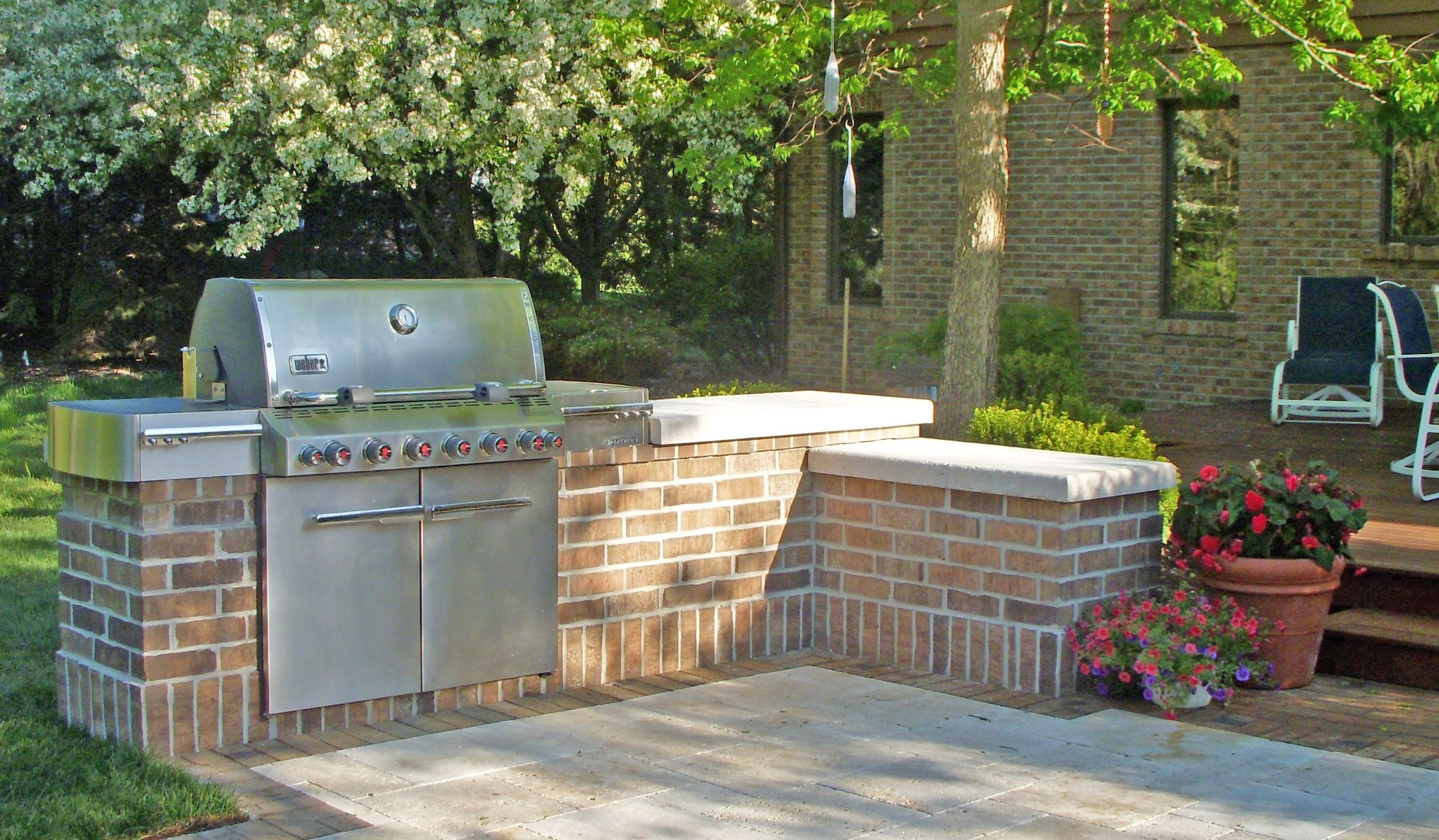 gas grill built into mortared brick surround with waukesha buff