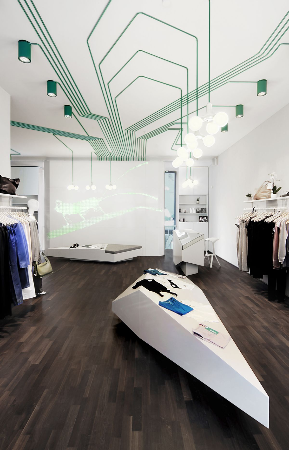 Modern fashion shop interior design with wooden floor for inspirational fashion shop interior design ideas