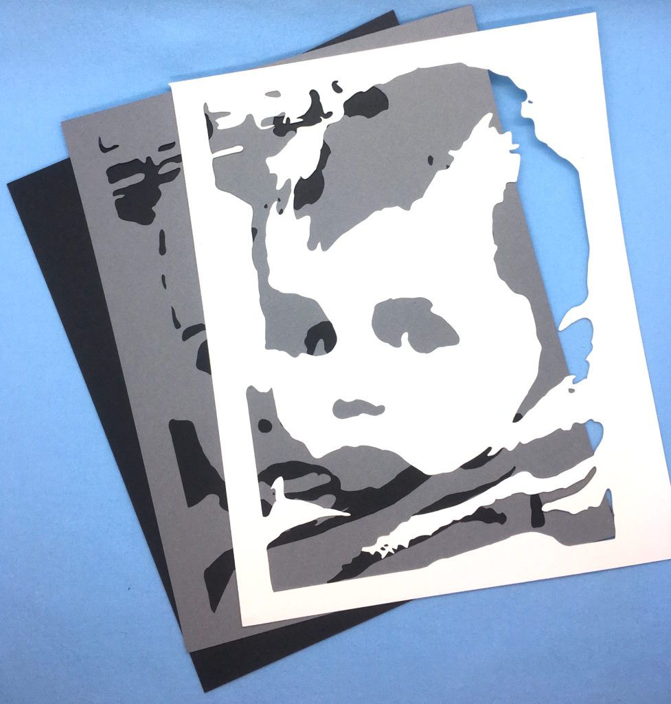 Layered stencils from a free svg generator make it simple to die cut paper portraits from your favorite photo