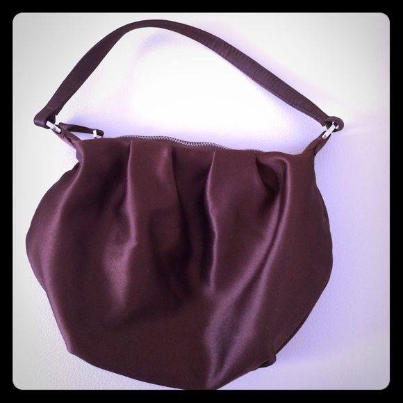Bath and body works brown satin bag Excellent condition. Can be used to gift bath and body works products or just as a small bag for going out. Zip closure. Cream interior with bath and body works logo. Lotion not included. bath and body works Bags Mini Bags
